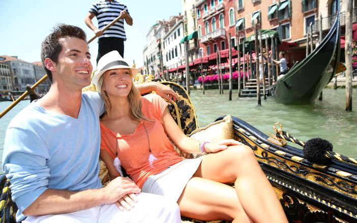 Young couple enjoying their vacation in Venice