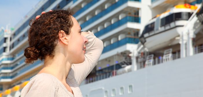 Girl staring at the huge cruise ship in the port